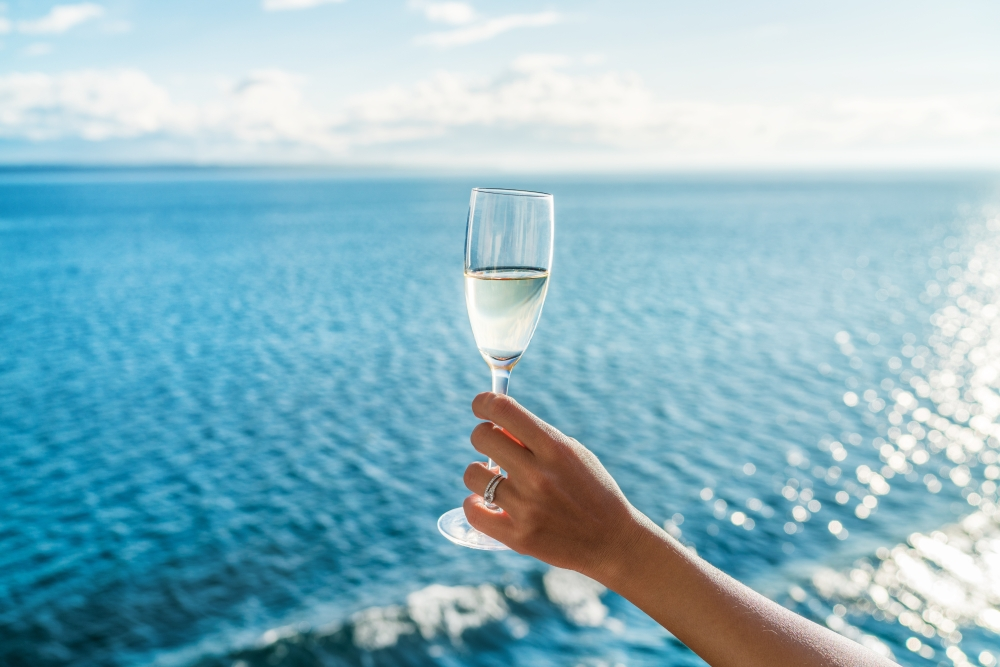 bigstock-Champagne-glass-woman-s-hand-t-168530816