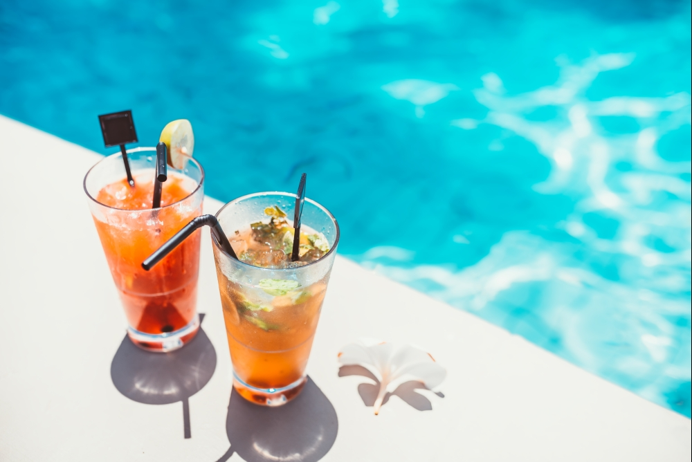 bigstock-Poolside-Symmetric-Cocktails-S-150356066